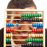 bigstock-Man-Looking-Through-Abacus-7241495FI