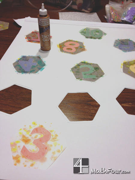 Glue stained glass numbers into a white roller blind for a special decorative math treat for your child's room or your classroom! MathFour.com
